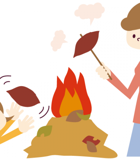 焼き芋を焼くお母さんと子供