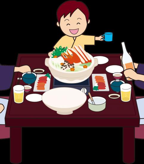 旅館でカニ鍋を食べる家族