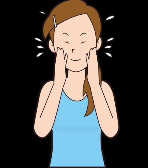 顔に保湿剤をつける女性