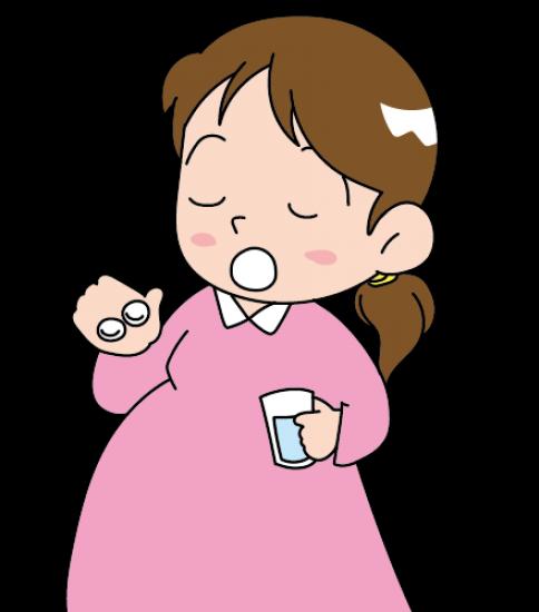 サプリを飲む妊婦