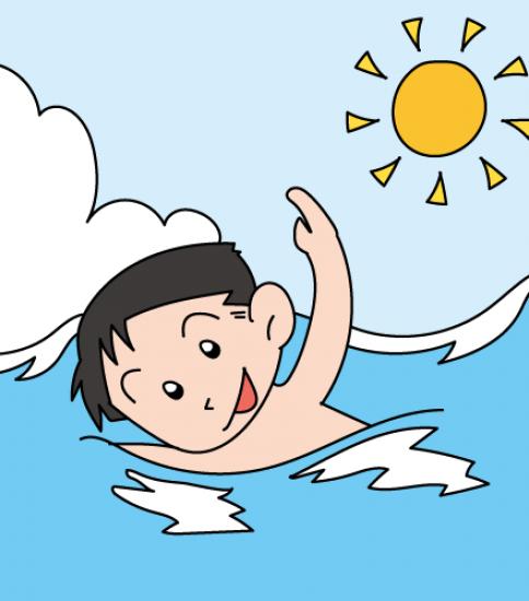 海で泳ぐ男の子