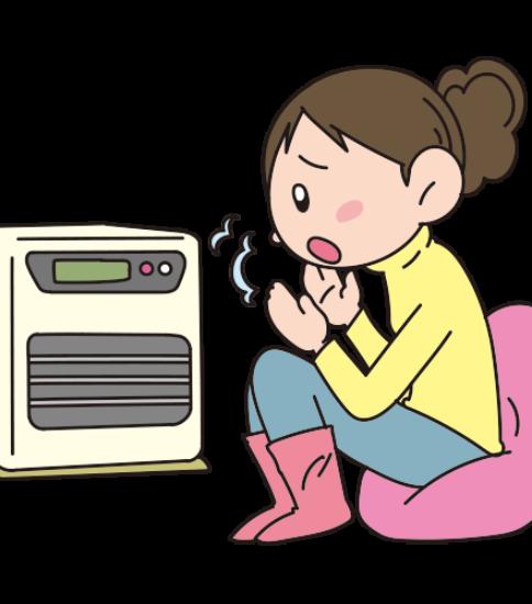 暖房が温まらないので寒そうにこごえる女性