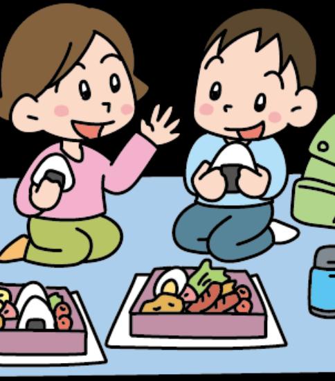 遠足で弁当を食べる女の子と男の子