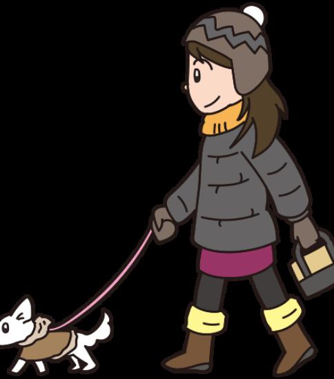 ダウンを着て犬の散歩をする女性