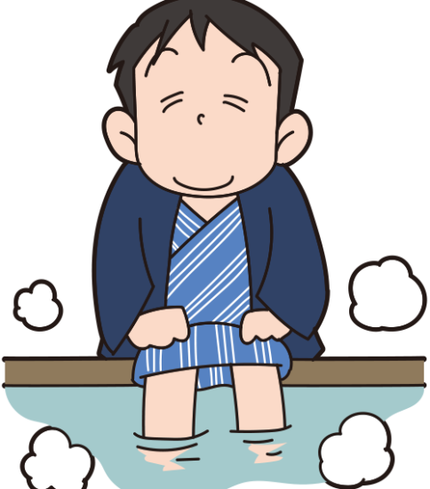 足湯に入る男性
