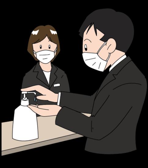 マスクをして受付・消毒